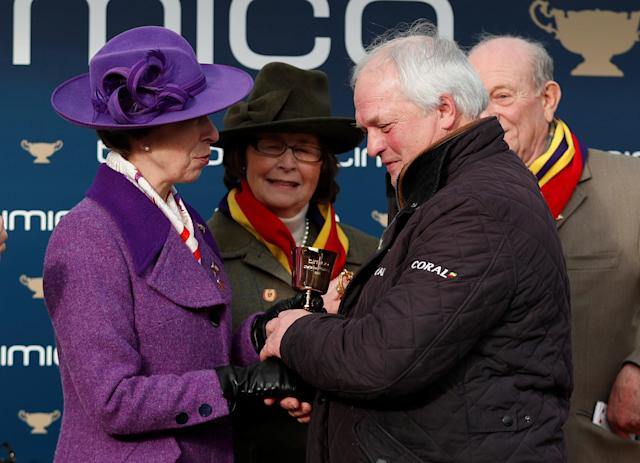 Horse Racing - Cheltenham Festival - Cheltenham Racecourse, Cheltenham, Britain - March 16, 2018 Trainer Colin Tizzard collects the trophy from Princess Anne after Richard Johnson rode Native River to victory in the 15.30 Timico Cheltenham Gold Cup Chase Action Images via Reuters/Andrew Boyers