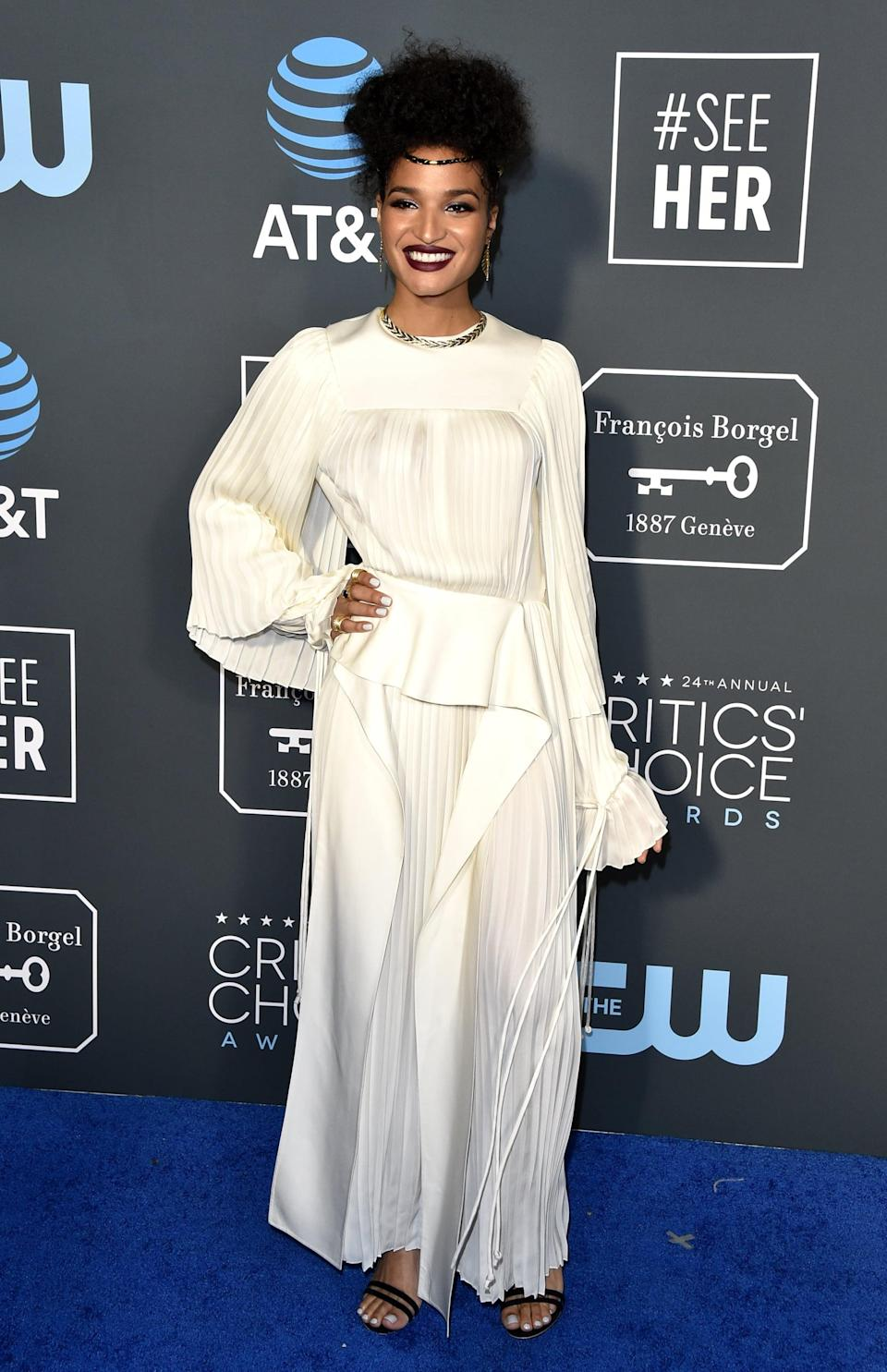 <p>Indya Moore wearing Louis Vuitton gown with Hueb earrings and Marco Bicego rings.</p>