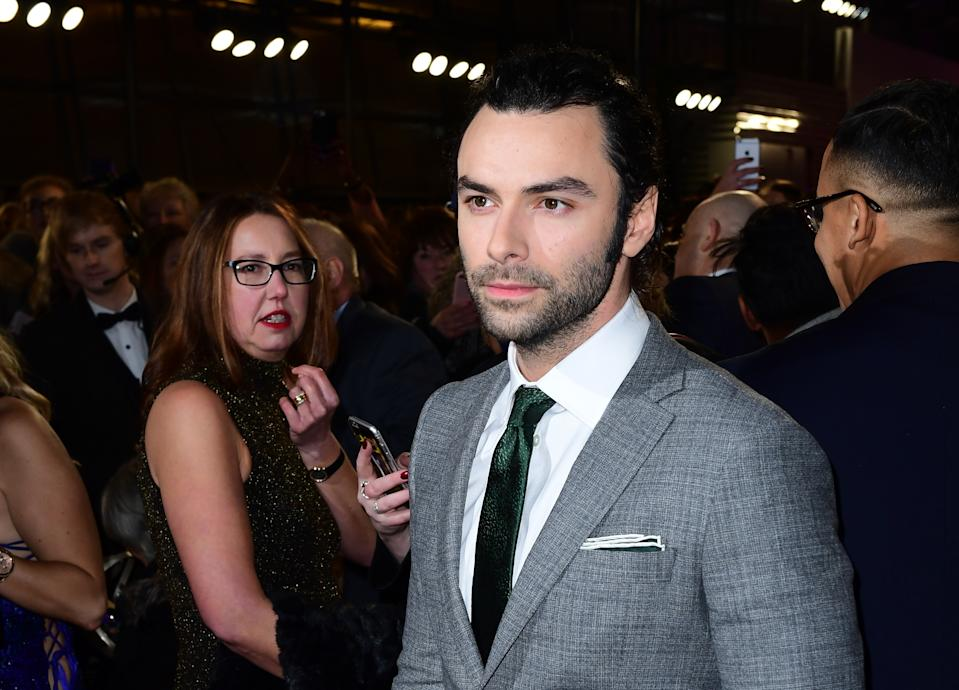 Aidan Turner arriving at the National Television Awards 2017 (Credit: Ian West/PA Images via Getty Images)
