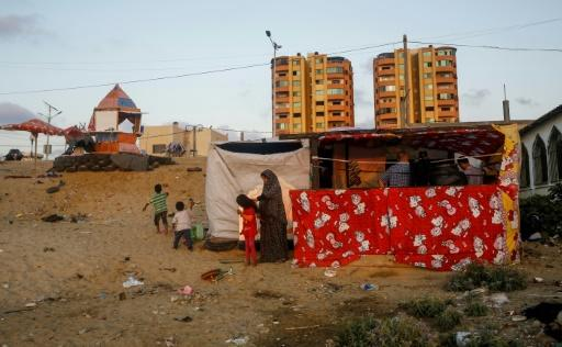 Hani and Noor al-Laham's financial woes have forced them to move to a homemade shack on the coast near Gaza City
