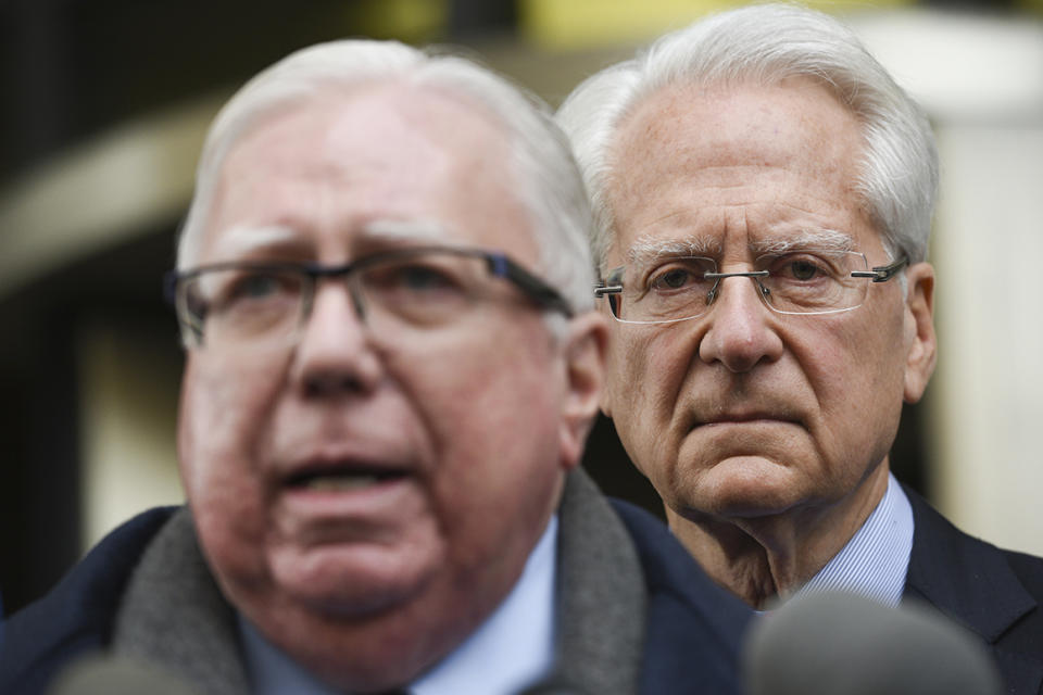 Jerome Corsi, left, speaks during a news conference in Jan. 2019 as his lawyer Larry Klayman stands behind him outside the federal courthouse in Washington.