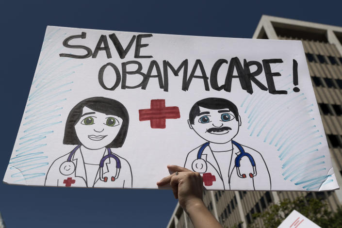 A supporter of the Affordable Care Act at a 2017 rally in Los Angeles. (Ronen Tivony/NurPhoto via Getty Images)