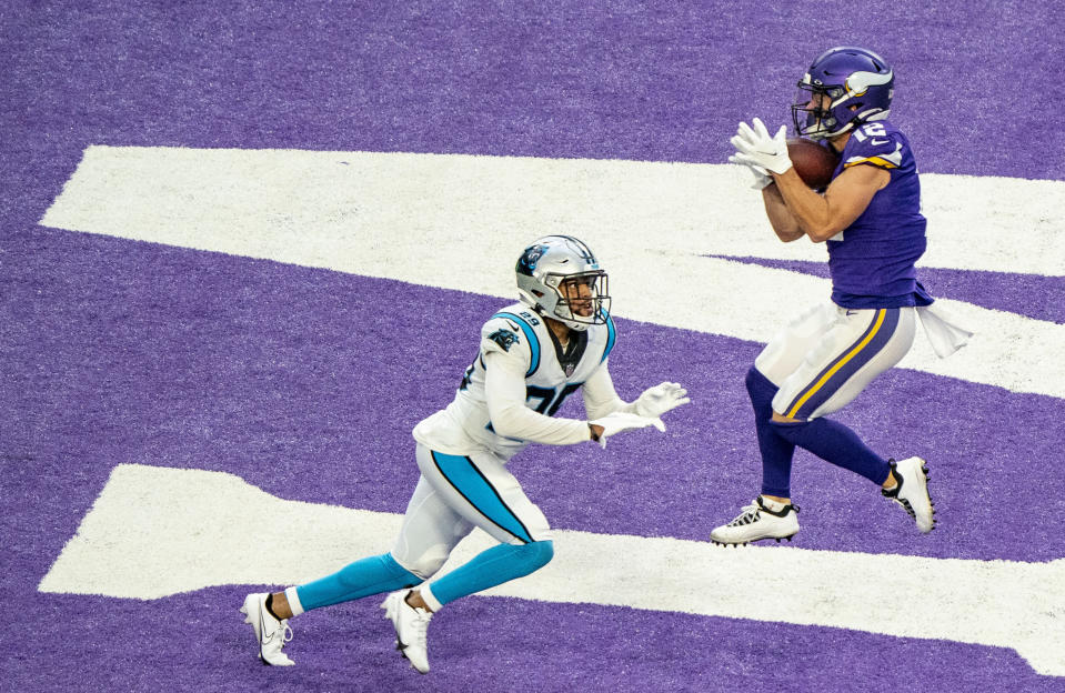 Minnesota Vikings wide receiver Chad Beebe (12) catches the winning touchdown pass over the head of Carolina Panthers cornerback Corn Elder (29) during an NFL football game in Minneapolis, Sunday, Nov. 29, 2020. (Alex Kormann/Star Tribune via AP)