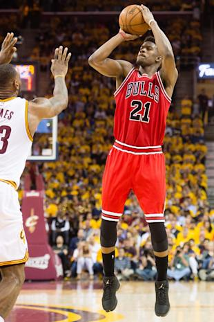 CLEVELAND, OH - MAY 4: Jimmy Butler #21 of the Chicago Bulls shoots over LeBron James #23 of the Cleveland Cavaliers in the second half during Game One in the Eastern Conference Semifinals of the 2015 NBA Playoffs 2015 at Quicken Loans Arena on May 4, 2015 in Cleveland, Ohio. The Bulls defeated the Cavaliers 99-92. NOTE TO USER: User expressly acknowledges and agrees that, by downloading and or using this photograph, User is consenting to the terms and conditions of the Getty Images License Agreement. (Photo by Jason Miller/Getty Images)