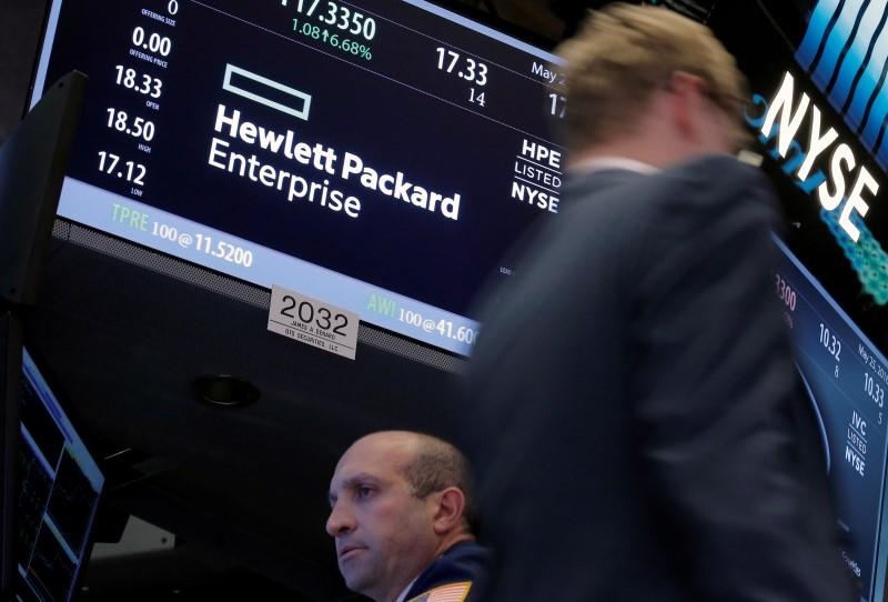 A trader passes by the post where Hewlett Packard Enterprise Co., is traded on the floor of the New York Stock Exchange