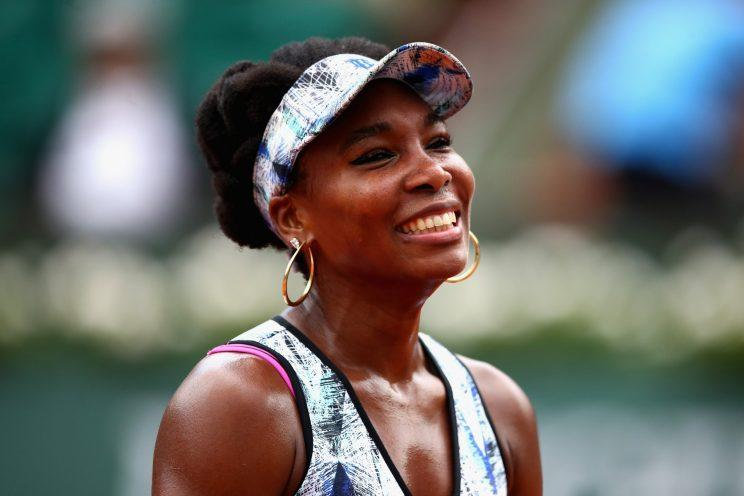 Venus Williams smiles during an interview after her third-round victory in the French Open. (Getty Images)