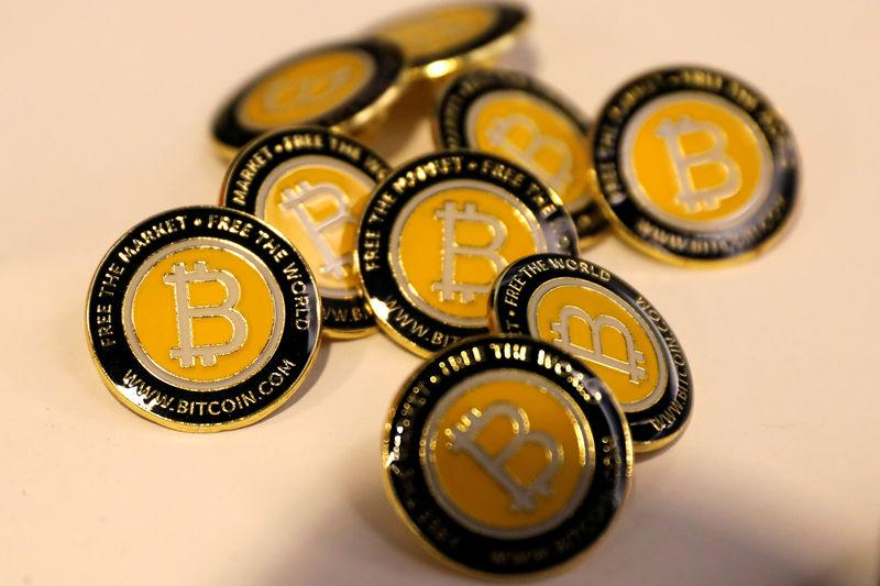 FILE PHOTO: Bitcoin.com buttons are seen displayed on the floor of the Consensus 2018 blockchain technology conference in New York City