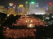 FILE - In this June 4, 2012, file photo, thousands of people attend a candlelight vigil in Hong Kong's Victoria Park to mark the anniversary of the military crackdown on a pro-democracy student movement in Beijing. (AP Photo/Kin Cheung, File)