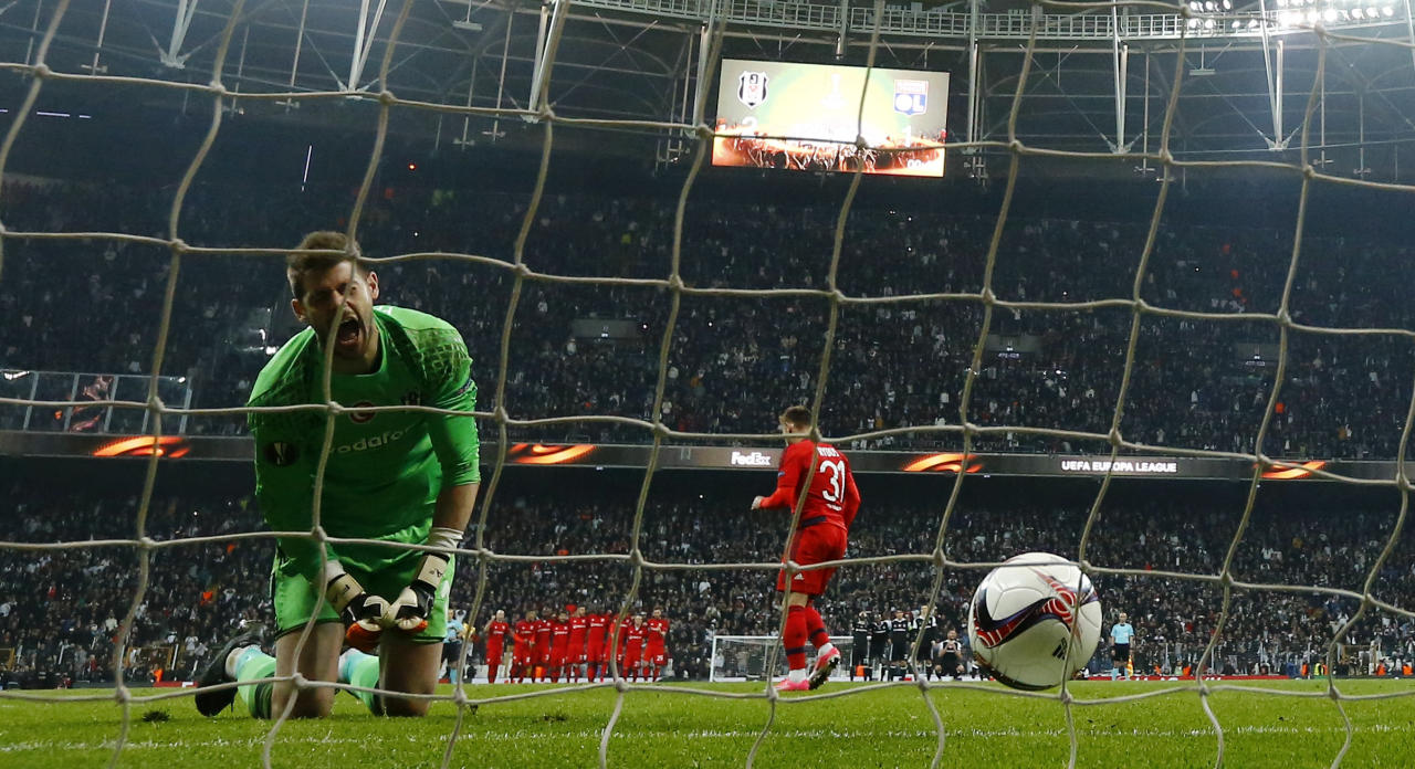 Football Soccer - Besiktas v Olympique Lyonnais - UEFA Europa League Quarter Final Second Leg - Vodafone Arena, Istanbul, Turkey - 20/4/17 Lyon's Maciej Rybus scores a penalty as Besiktas' Fabricio looks dejected  Reuters / Murad Sezer Livepic