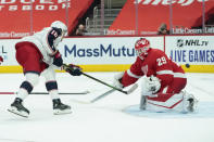 Columbus Blue Jackets center Pierre-Luc Dubois (18) beats Detroit Red Wings goaltender Thomas Greiss (29) for a goal in the third period of an NHL hockey game Monday, Jan. 18, 2021, in Detroit. (AP Photo/Paul Sancya)