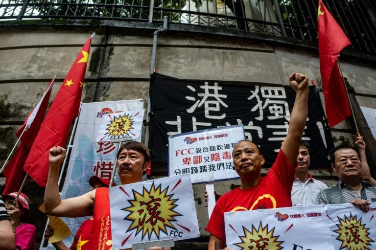 "The pro-Beijing groups gathered outside waved China's national flag, chanting ""Get out of Hong Kong! We Chinese people don't welcome you!"", describing the FCC as ""thieves"""
