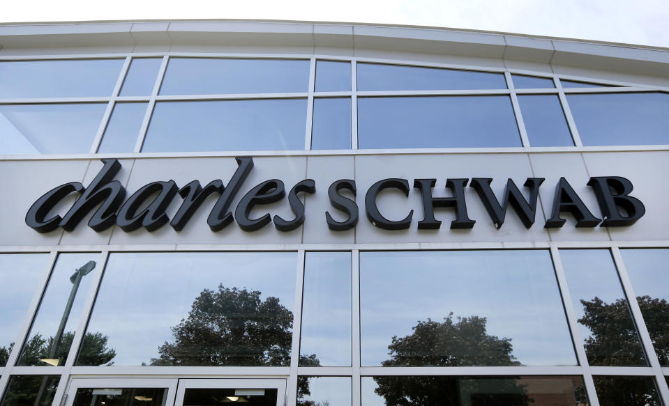 This Monday, July 18, 2016, photo shows a branch of Charles Schwab, in Burlington, Mass. Charles Schwab reports financial results on Monday, Oct. 17, 2016. (AP Photo/Elise Amendola)