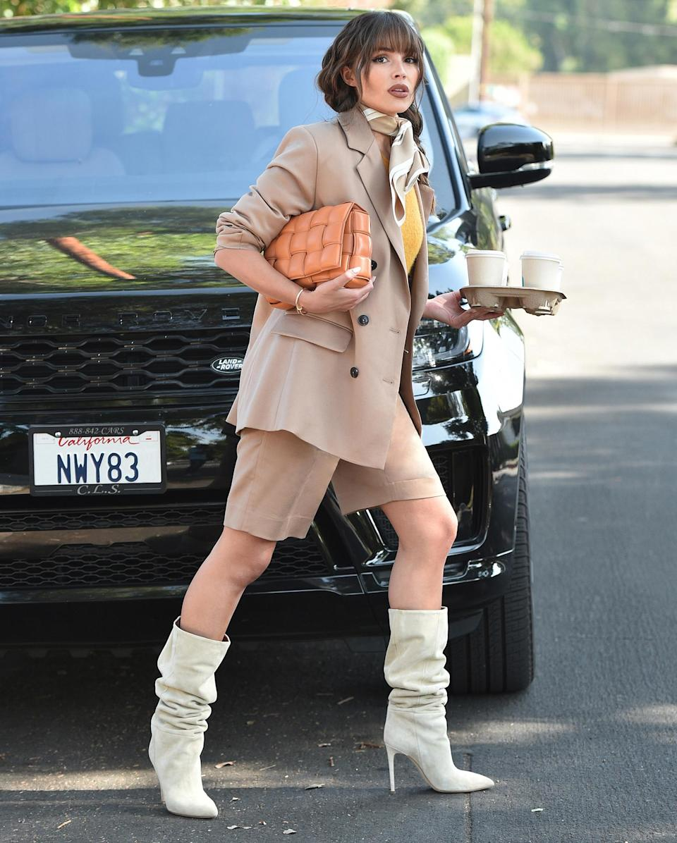 <p>Olivia Culpo has her hands full while on her way to a meeting for her Culpos x Inc for Macy's clothing line on Thursday in L.A.</p>