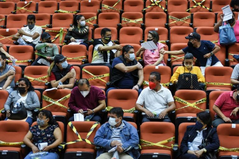 Teachers wait in observation after receiving a Covid-19 shot in San Cristobal, Mexico