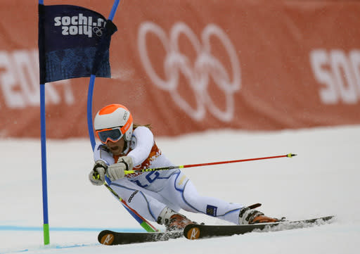 Sweden's Frida Hansdotter passes a gate in the first run of the women's giant slalom at the Sochi 2014 Winter Olympics, Tuesday, Feb. 18, 2014, in Krasnaya Polyana, Russia.(AP Photo/Luca Bruno)