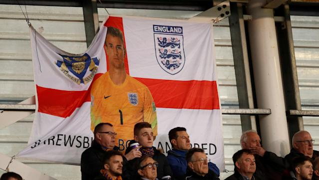 "Soccer Football - League One - Shrewsbury Town vs Charlton Athletic - Montgomery Waters Meadow, Shrewsbury, Britain - April 17, 2018 General view of an England flag in support of former Shrewsbury Town player Joe Hart Action Images/Andrew Boyers EDITORIAL USE ONLY. No use with unauthorized audio, video, data, fixture lists, club/league logos or ""live"" services. Online in-match use limited to 75 images, no video emulation. No use in betting, games or single club/league/player publications. Please contact your account representative for further details."