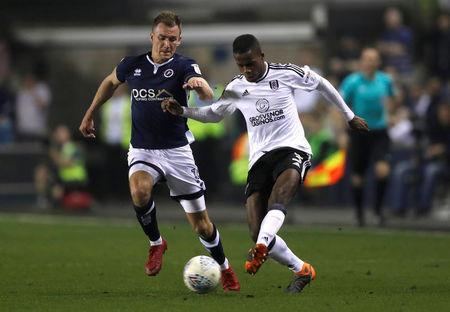 Soccer Football - Championship - Millwall v Fulham - The Den, London, Britain - April 20, 2018 Fulham's Ryan Sessegnon in action with Millwall's Jed Wallace Action Images/Matthew Childs