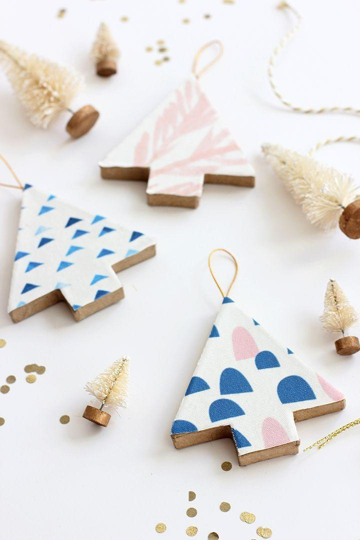 """<p>DIY gifts don't have to look fuddy-duddy, you know! We love the modern look of these whimsical ornaments, which can be customized with just about whatever pattern you want.</p><p><strong>Get the tutorial at <a href=""""http://www.aliceandlois.com/diy-fabric-covered-tree-ornaments/"""" rel=""""nofollow noopener"""" target=""""_blank"""" data-ylk=""""slk:Alice & Lois"""" class=""""link rapid-noclick-resp"""">Alice & Lois</a>.</strong></p><p><a class=""""link rapid-noclick-resp"""" href=""""https://www.amazon.com/Mod-Podge-Waterbase-16-Ounce-CS11302/dp/B001IKES5O?tag=syn-yahoo-20&ascsubtag=%5Bartid%7C10050.g.645%5Bsrc%7Cyahoo-us"""" rel=""""nofollow noopener"""" target=""""_blank"""" data-ylk=""""slk:SHOP MOD PODGE"""">SHOP MOD PODGE</a></p>"""