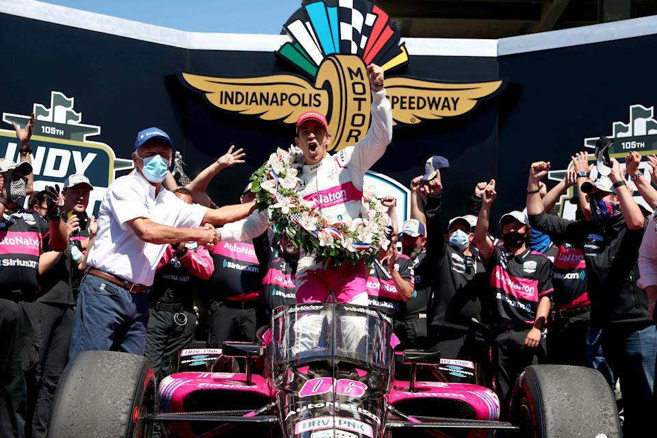 Meyer Shank Racing driver Helio Castroneves (6) celebrates in Victory Circle on Sunday, May 30, 2021, after winning the 105th running of the Indianapolis 500 at Indianapolis Motor Speedway.