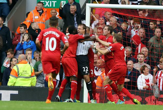 Liverpool's goalkeeper Simon Mignolet is congratulated by teammates after a double save during the Barclays Premier League match at Anfield, Liverpool.