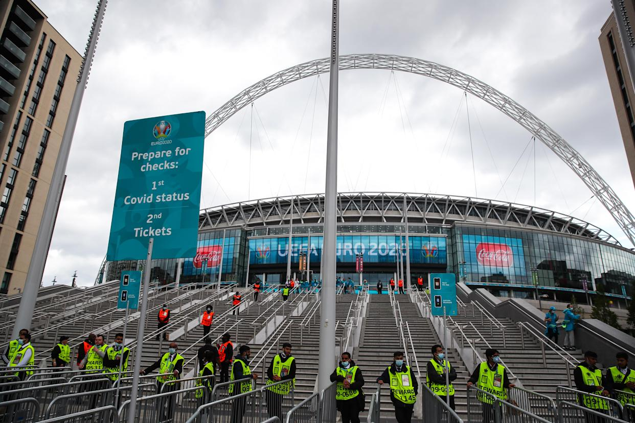 LONDON, ENGLAND - JULY 11: A general external view of Wembley with stewards and security manning the stairs behind Covid checks signage ahead of the UEFA Euro 2020 Championship Final between Italy and England at Wembley Stadium on July 11, 2021 in London, United Kingdom. (Photo by Robbie Jay Barratt - AMA/Getty Images)