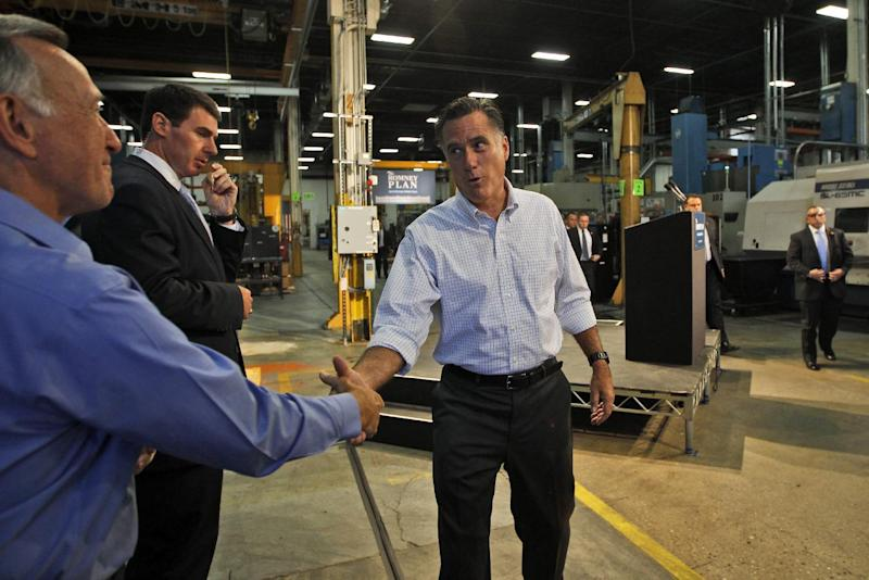Republican presidential candidate, former Massachusetts Gov. Mitt Romney thanks Warren Young, chief executive officer at Acme Industries, as he campaigns in Elk Grove Village, Ill.,Tuesday, Aug. 7, 2012. (AP Photo/Charles Dharapak)