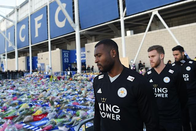 Wes Morgan (L) looks at the floral tributes (Photo by Mike Egerton/PA Images via Getty Images)