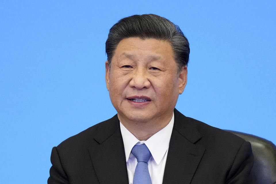 FILE - In this July 6, 2021, file photo released by Xinhua News Agency, Chinese President Xi Jinping delivers a speech at the CPC and World Political Parties Summit in Beijing. Xi pledged 2 billion doses of Chinese vaccines would be supplied to the world through this year and $100 million would be donated to a U.N.-backed distribution program, state media reported. (Li Xueren/Xinhua via AP, File)