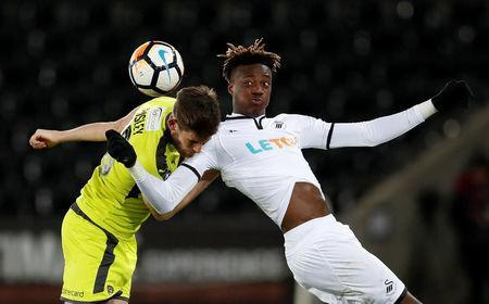 Soccer Football - FA Cup Fourth Round Replay - Swansea City vs Notts County - Liberty Stadium, Swansea, Britain - February 6, 2018 Swansea City's Tammy Abraham in action with Notts County's Shaun Brisley Action Images via Reuters/Matthew Childs