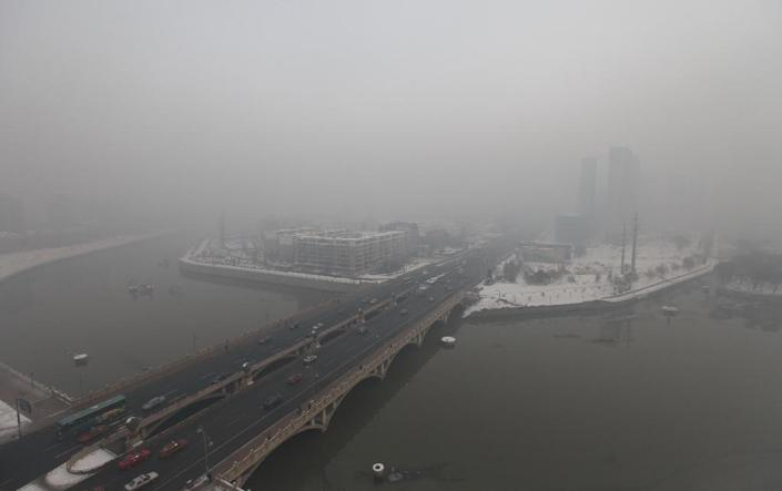 A residential block covered in smog in Changchun, northeast China's Jilin province (AFP Photo/STR)