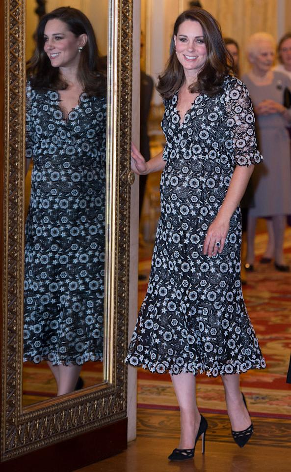 <p>The Duchess of Cambridge donned a monochrome floral dress by Erdem for The Commonwealth Fashion Exchange Reception at Buckingham Palace on February 19th. She accessorised the look with her go-to Prada wavy-cut heels. <em>[Photo: Getty]</em> </p>