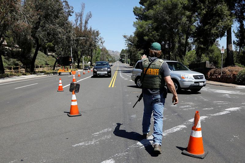 A San Diego County Sheriffís Deputy secures the scene of a shooting incident at the Congregation Chabad synagogue in Poway, north of San Diego, April 27, 2019. (Photo: John Gastaldo/Reuters)