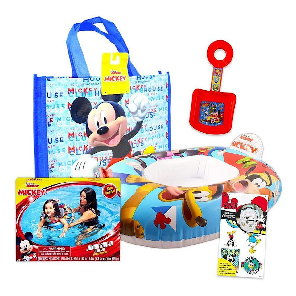 """<p><strong>Disney Studio</strong></p><p>amazon.com</p><p><a href=""""https://www.amazon.com/dp/B08WJNZ44B?tag=syn-yahoo-20&ascsubtag=%5Bartid%7C2089.g.36560252%5Bsrc%7Cyahoo-us"""" rel=""""nofollow noopener"""" target=""""_blank"""" data-ylk=""""slk:Shop Now"""" class=""""link rapid-noclick-resp"""">Shop Now</a></p><p>It's a one-stop shop with this Mickey Mouse Bundle. It comes with a tote bag so you can carry the beach shovel and pool float that also come with the order. </p><p>(Pssst ... this also makes an adorable gift for the kid in your life.)</p>"""