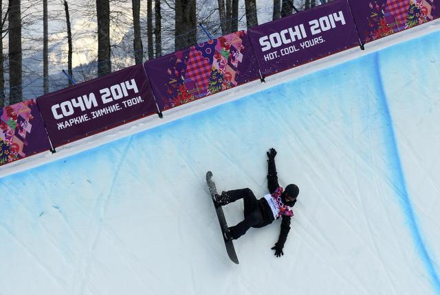 Switzerland's Iouri Podladtchikov competes during the men's snowboard halfpipe qualification round at the 2014 Sochi Winter Olympic Games in Rosa Khutor