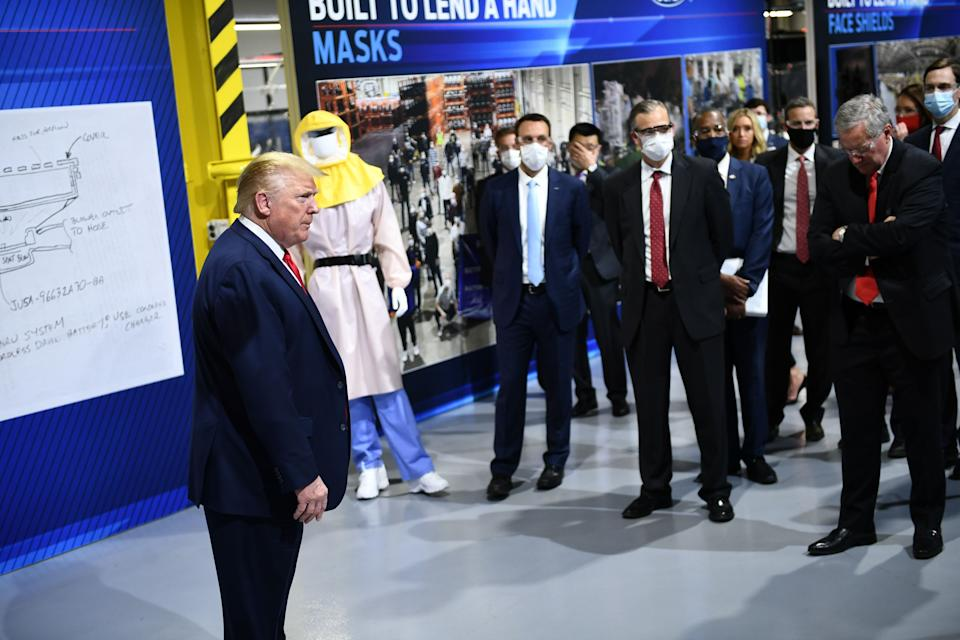 President Donald Trump tours a Ford Motor plant that was converted to making personal protection and medical equipment in Ypsilanti, Mich., on May 21.