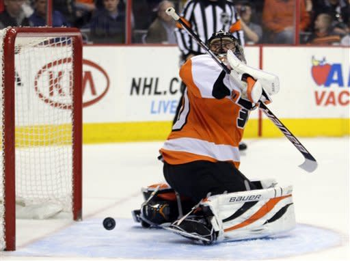 Philadelphia Flyers' Ilya Bryzgalov looks over his shoulder as the puck shot by New York Rangers' Rick Nash bounces back out of the net for a goal in the first period of an NHL hockey game, Tuesday, March 26, 2013, in Philadelphia. (AP Photo/Tom Mihalek)