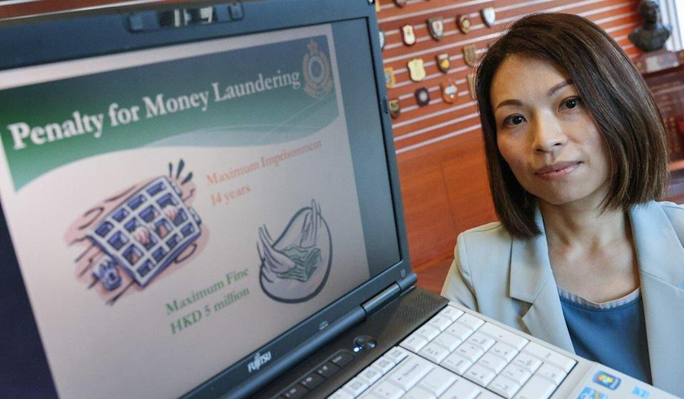 Grace Tang displays a slide showing the maximum penalty for money laundering. Photo: May Tse