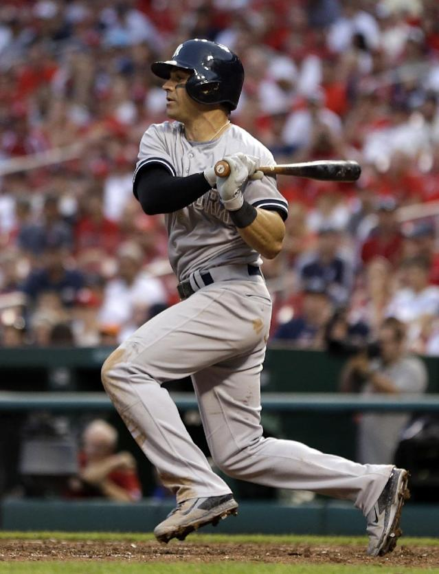 New York Yankees' Brian Roberts follows through on an RBI single during the 12th inning of a baseball game against the St. Louis Cardinals Monday, May 26, 2014, in St. Louis. The Yankees won 6-4. (AP Photo/Jeff Roberson)