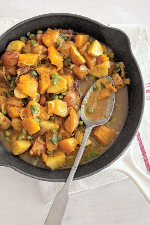 "Flavor tender pumpkin and tomatoes with a touch of curry powder in this tempting dish. <a href=""https://www.countryliving.com/food-drinks/recipes/a2994/curried-pumpkin-peas-recipe/"" rel=""nofollow noopener"" target=""_blank"" data-ylk=""slk:Get the recipe."" class=""link rapid-noclick-resp""><strong>Get the recipe.</strong></a>"