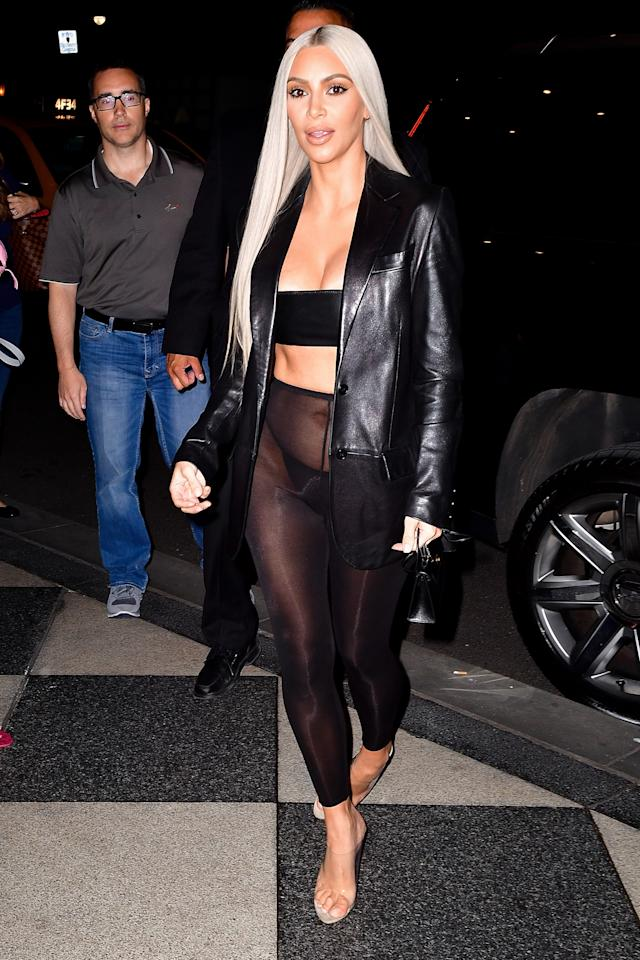 <p>In a leather blazer, black bandeau, sheer leggings, black string panties, and clear Yeezy heels while out in New York.</p>