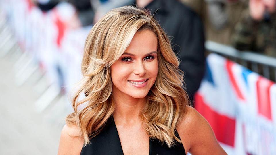 Amanda Holden celebrated turning 50 by posing nude on top of a giant birthday cake. Photo: Getty