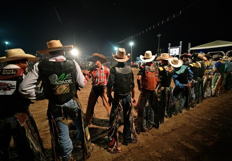 Riders prepare before competing at a rodeo event in Monte Negro in the southern Amazon basin (AFP Photo/CARL DE SOUZA)