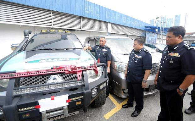 Perak police chief Commissioner Datuk Hasnan Hassan showing the vehicles seized under Ops Cantas Silver 1, February 19, 2018.