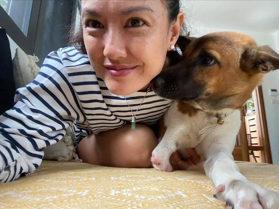 Nini Vilivong, 37, with the three-legged dog named Gucci that she adopted from Vientian-based animal shelter Vimaan Suan. (PHOTO: Nini Vilivong)