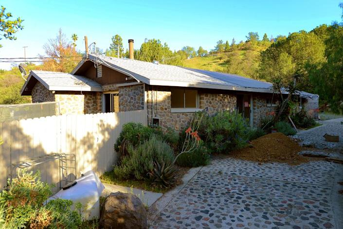 <p>The larger of the two parcels that make up the ranch has a main house and two guesthouses. One of those guesthouses is a two-bedroom, one-bath house, and the other is a three-bedroom, two-bath house.</p><p><i>(Photo: Total Agent)</i><br></p>