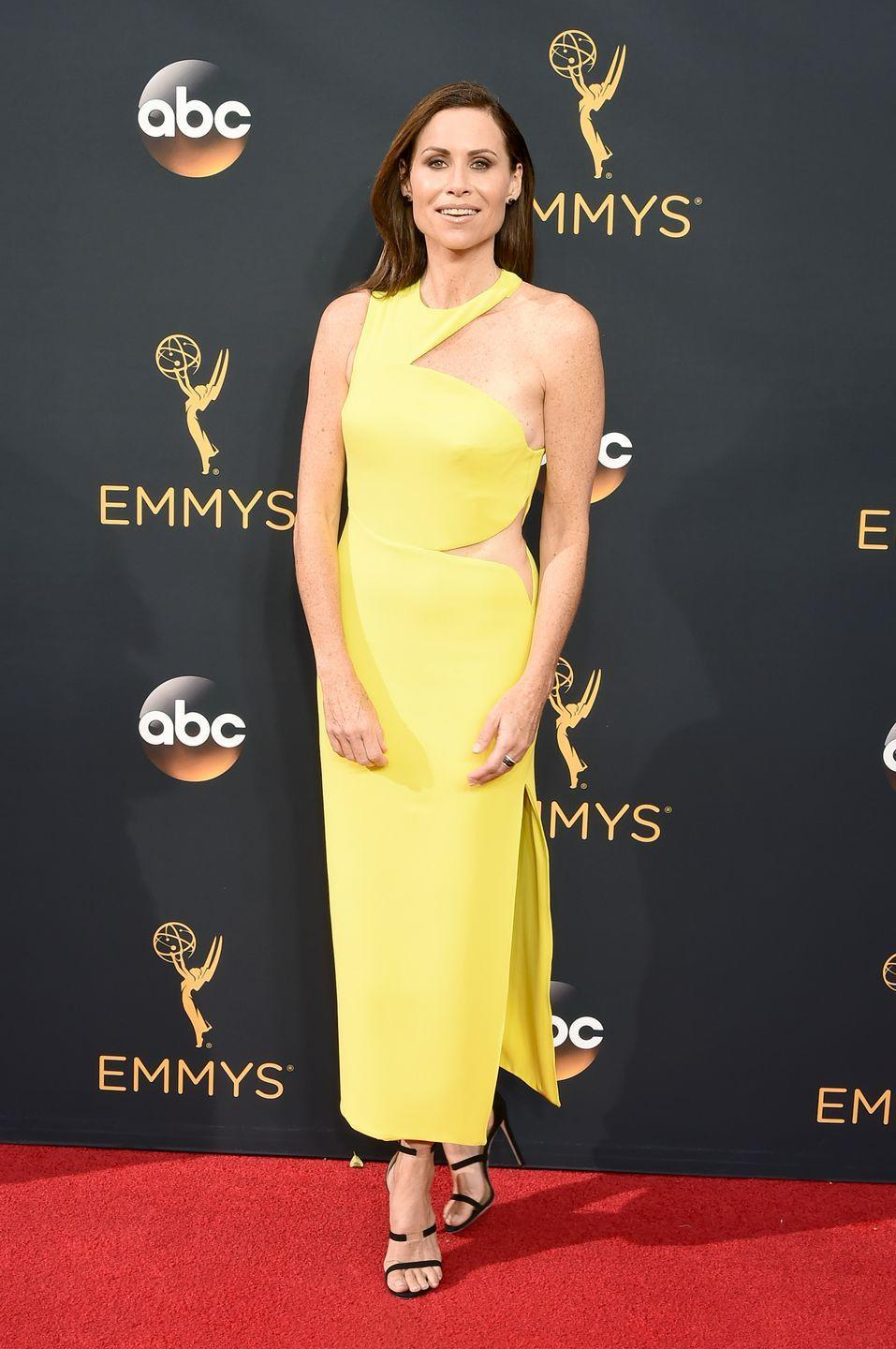 <p>The actress went bold in a shocking yellow dress with a sultry cut-out at her hip. </p>