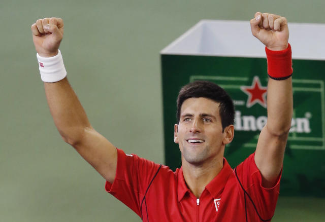 Serbia's Novak Djokovic celebrates after defeating Juan Martin del Potro of Argentina during the final match of the Shanghai Masters tennis tournament at Qizhong Forest Sports City Tennis Center in Shanghai, China, Sunday, Oct. 13, 2013. Djokovic won 6-1, 3-6, 7-6 (3). (AP Photo/Eugene Hoshiko)