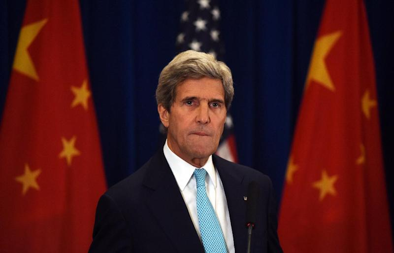 US Secretary of State John Kerry listens to a question at a press conference in Beijing on July 10, 2014 (AFP Photo/Greg Baker)