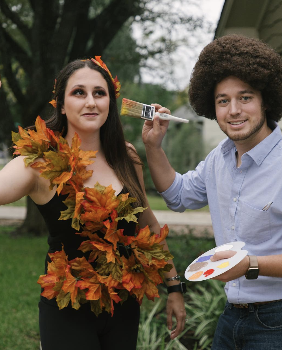 """<p>Bob Ross is painting his happy tree and showing off his canvas around the town. To recreate the look, just follow these <a href=""""https://sundanceandcompany.com/blog/halloween-2018"""" rel=""""nofollow noopener"""" target=""""_blank"""" data-ylk=""""slk:simple steps"""" class=""""link rapid-noclick-resp"""">simple steps</a>!</p><p><a class=""""link rapid-noclick-resp"""" href=""""https://www.amazon.com/Ross-Wearable-Painting-Couples-Costume/dp/B07GL3BVF4/?tag=syn-yahoo-20&ascsubtag=%5Bartid%7C10072.g.27868801%5Bsrc%7Cyahoo-us"""" rel=""""nofollow noopener"""" target=""""_blank"""" data-ylk=""""slk:SHOP SIMILAR"""">SHOP SIMILAR</a></p>"""