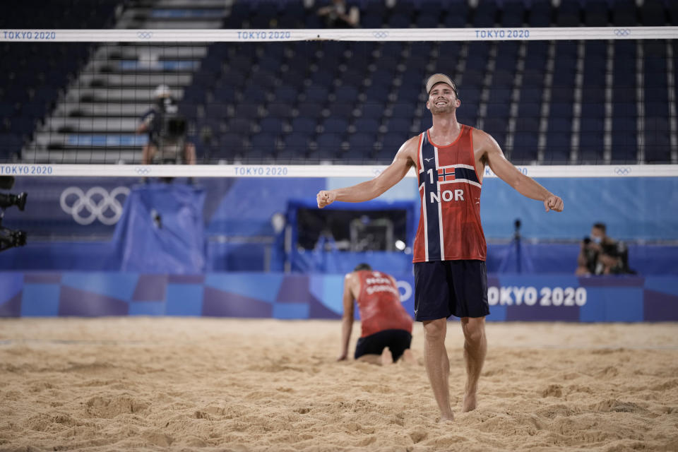 Anders Berntsen Mol, right, of Norway, and teammate Christian Sandlie Sorum, celebrate winning a men's beach volleyball semifinal match against Latvia at the 2020 Summer Olympics, Thursday, Aug. 5, 2021, in Tokyo, Japan. (AP Photo/Felipe Dana)